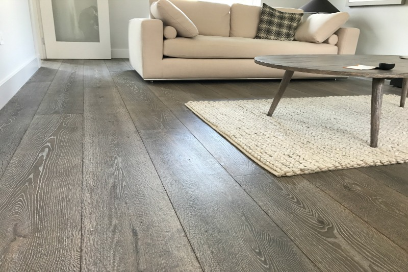 Grey oak flooring in a living room setting