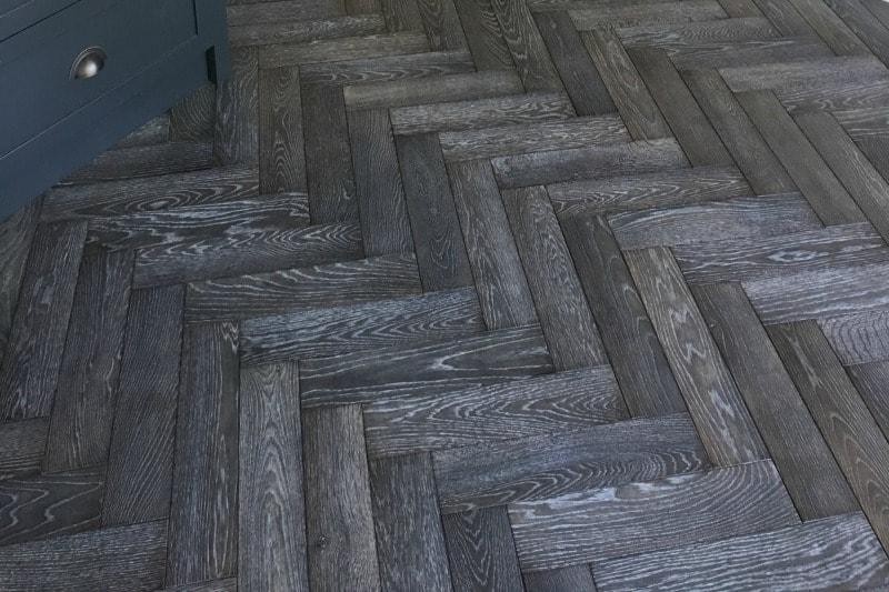 Grey herringbone flooring