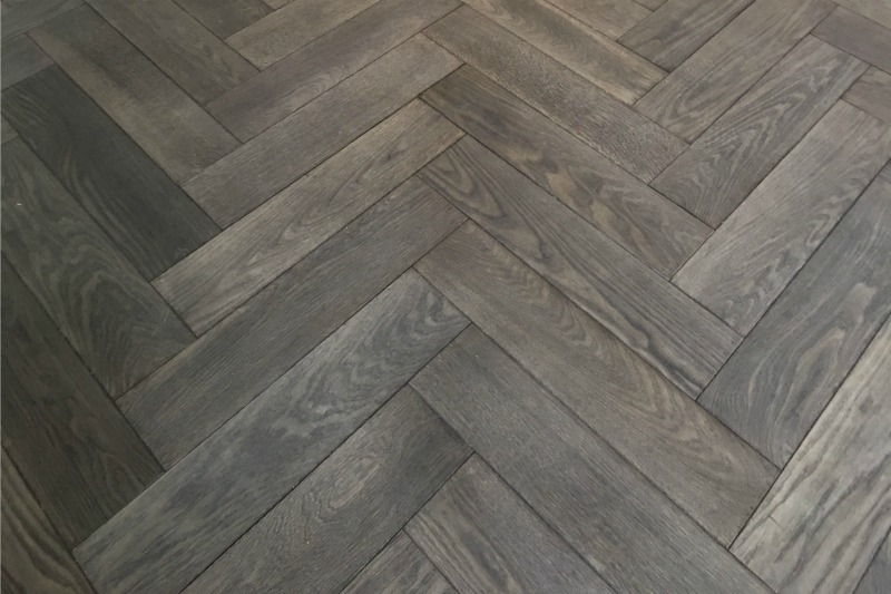 Blue toned oak flooring in a herringbone pattern
