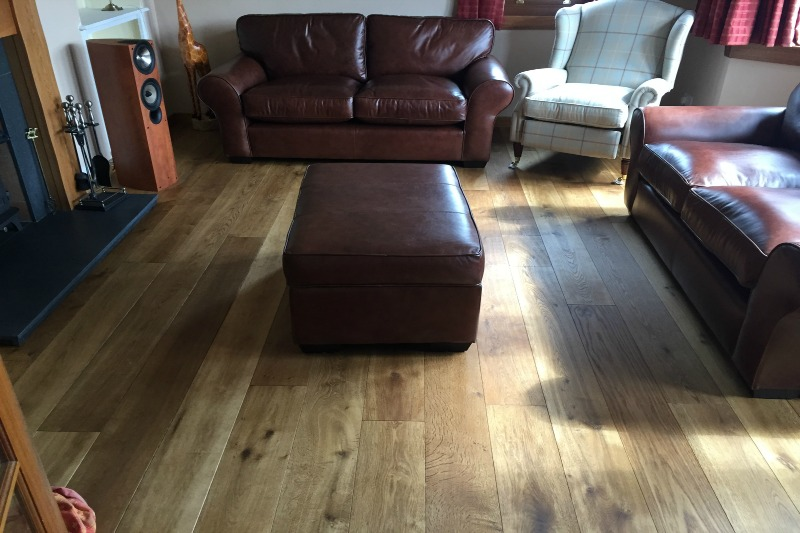 Amber and treacle coloured oak flooring in a living room