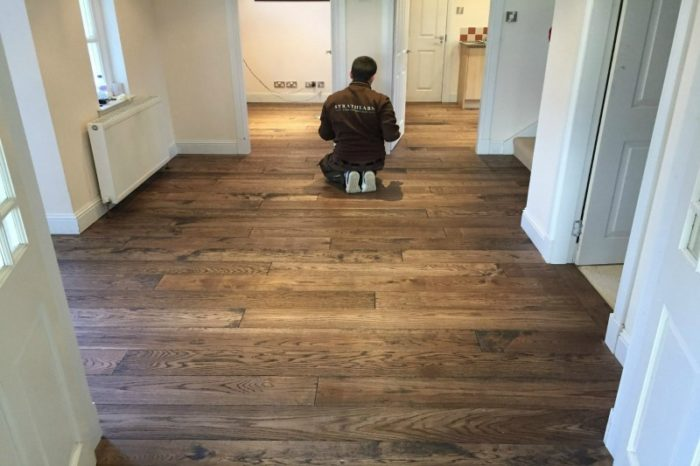 Brown toned oak flooring with a strathearn installer kneeling