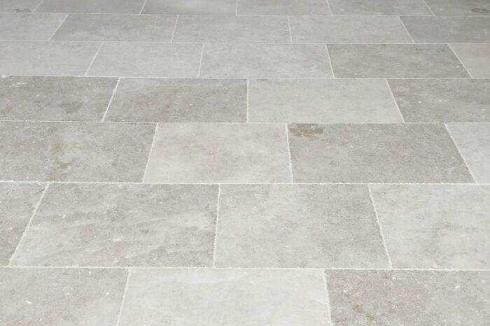 Pale grey limestone flagstone floor