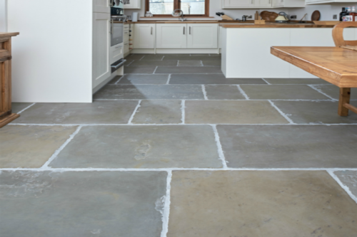 Green toned sandstone flooring in kitchen setting
