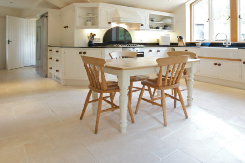 Cream tumbled limestone in a kitchen setting