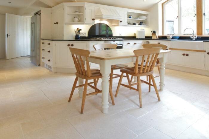 Cream tumbled limestone in a kitchen setting