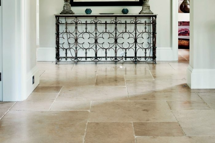 Beige amber limestone with a tumbled finish, in a hall setting