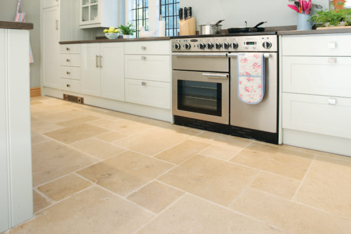 Beige amber limestone with a tumbled finish, in a kitchen setting