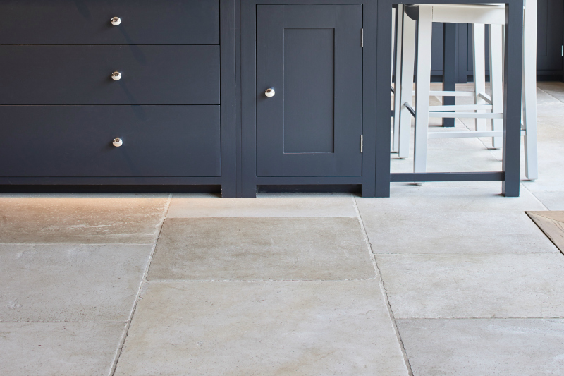 Beige limestone with a kitchen unit set behind