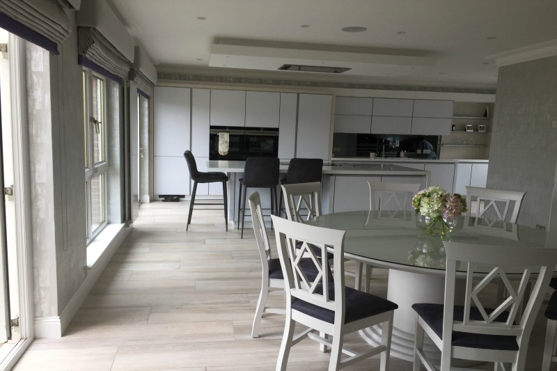 Pale wood effect plank in kitchen dining area