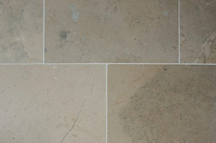 Beige and fleks of blue limestone swatch