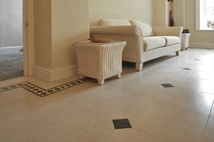 Cream limestone with Cabouchon insert in a conservatory setting
