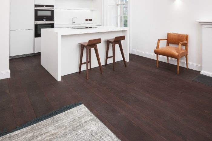 Dark red oak flooring in a kitchen area