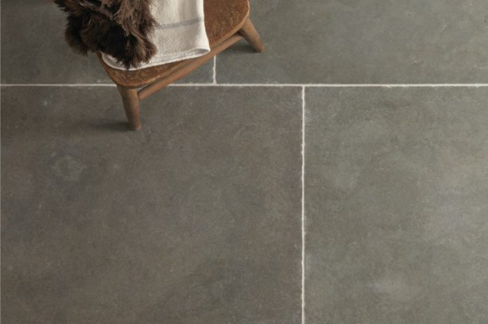 Grey limestone with a small chair in background