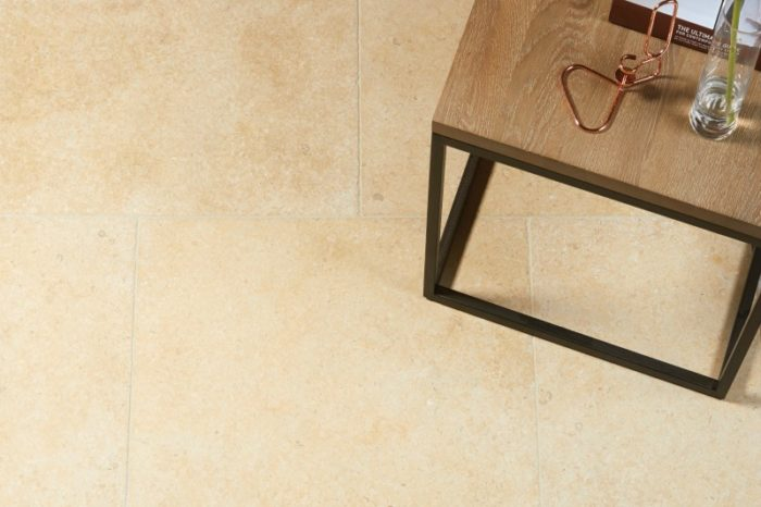 Golden tumbled limestone with a side table in image