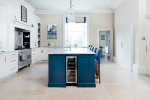 Cream limestone in a blue kitchen