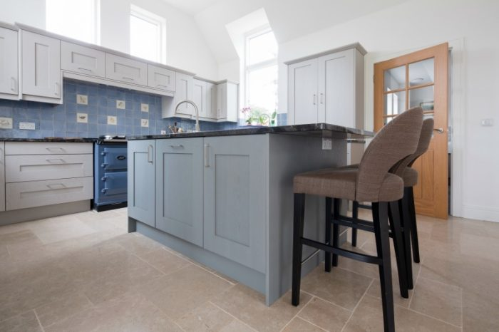 Cream limestone in a blue kitchen setting