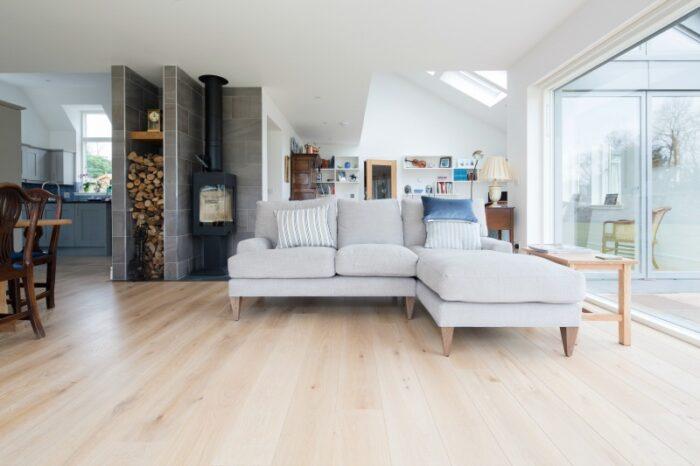 Pale oak flooring in open living dining area