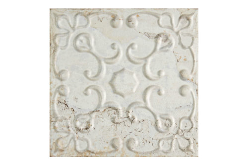 Aged white decorative tile