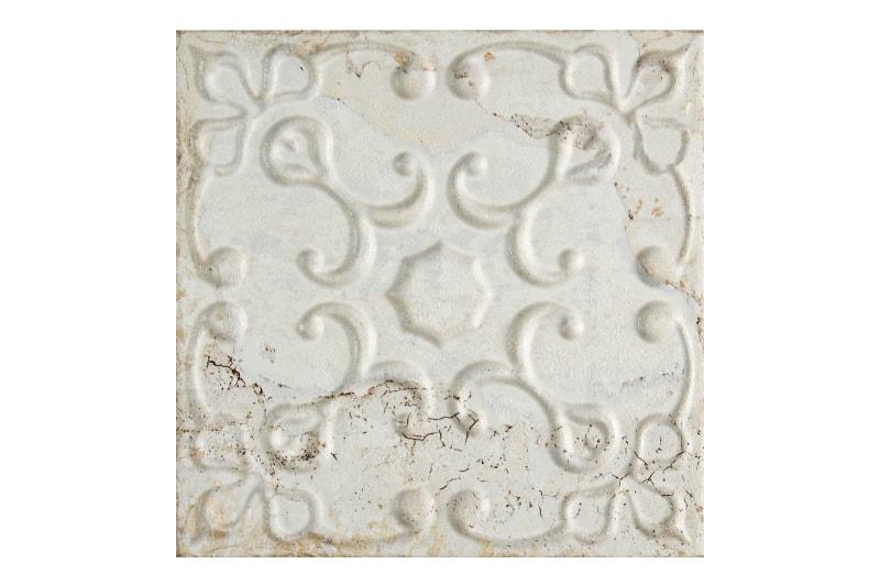 Aged white decorative tile