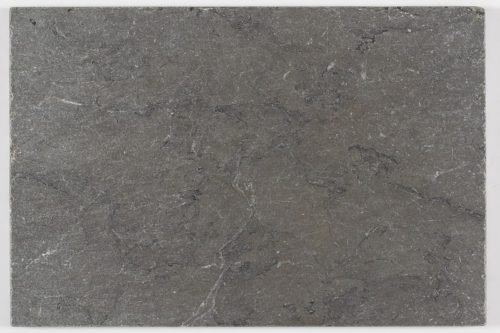 Tumbled dark grey limestone swatch