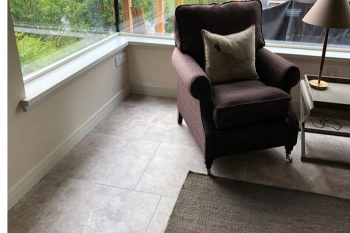 Grey tumbled limestone floor in a living room setting