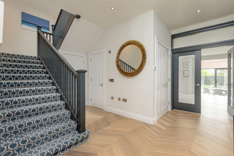 White oiled oak floor in hallway with stairs