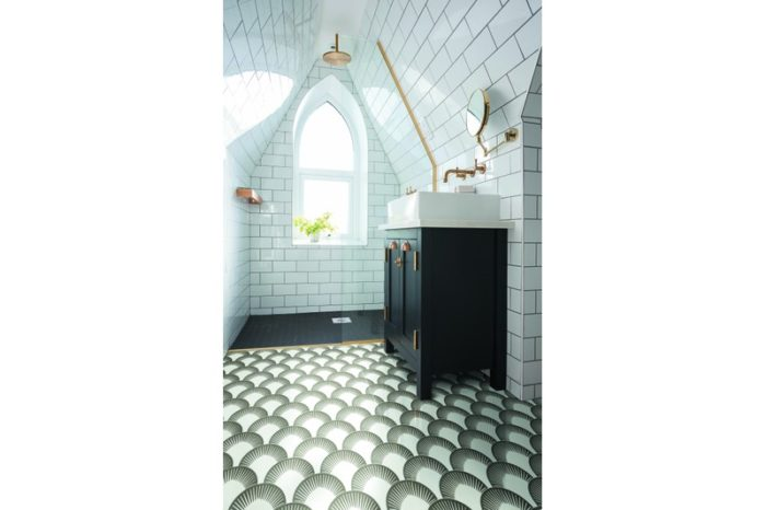 Scalloped shaped tile in a black and white background in situ