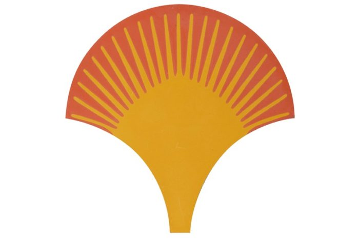 Scalloped shaped tile in a yellow and orange background swatch