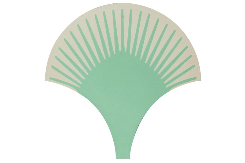 Scalloped shaped tile in a white and green background swatch