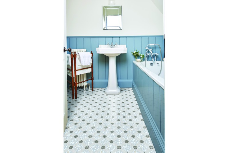 Speckled blue decor tile in situ