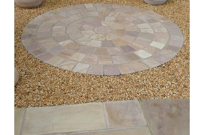 pink sandstone circle surrounded by gravel