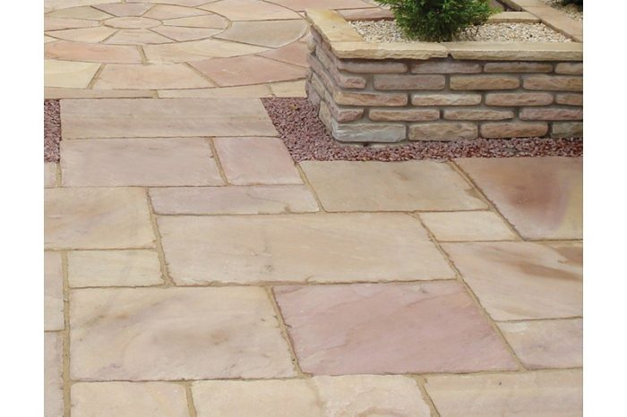 ink sandstone paving with a circle design in the background