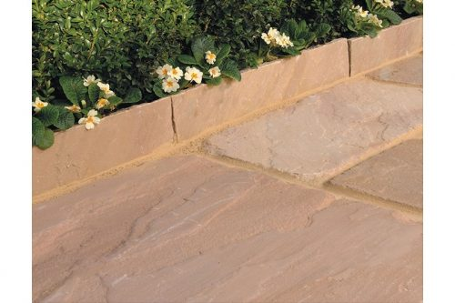 sandstone edging around a flower bed