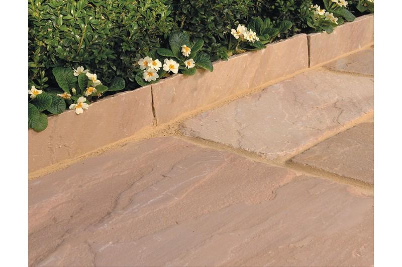 sandstone edging around a flower bed