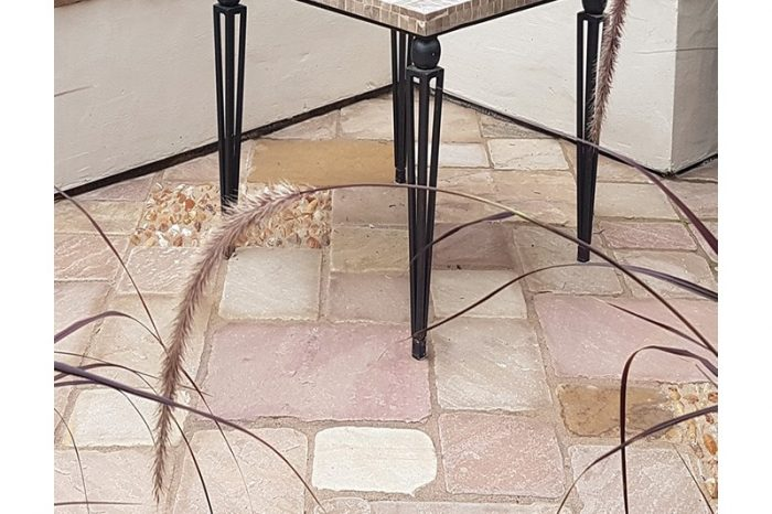 pink sandstone cobbles with a table on top