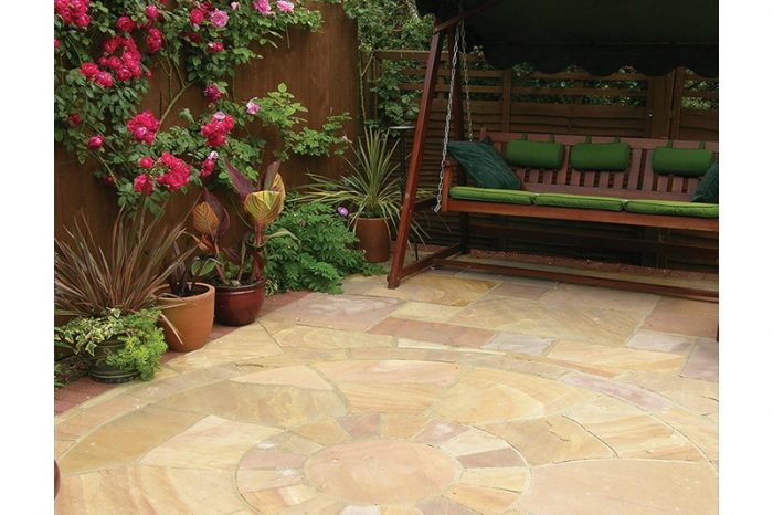sandstone circle paving with swing bench in background