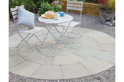 sandstone circle paving with a white table on top