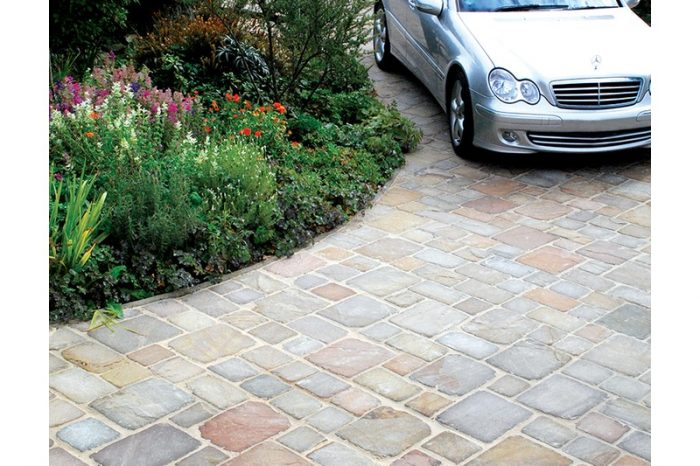 cobbled driveway with car parked in distance