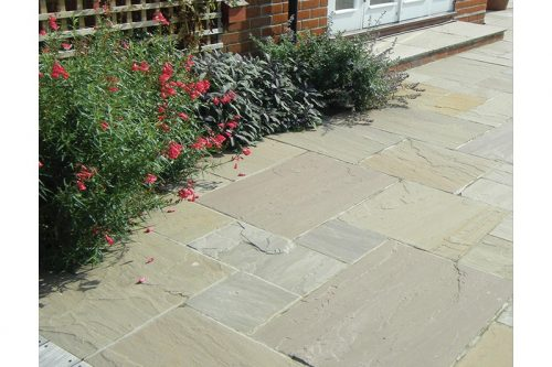 york green paving flas with a flower bed in the background