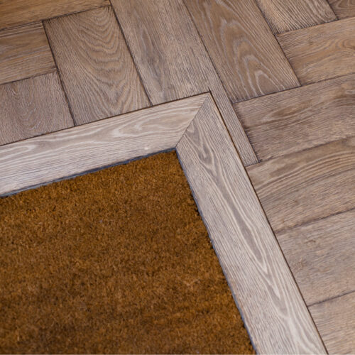 inserted coir mar with herringbone flooring