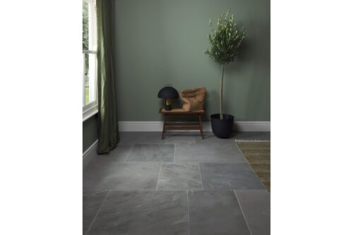 grey sandstone floor with chair in background