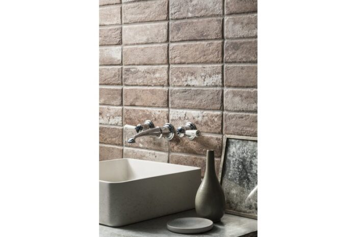 aged brick tile with basin and tap