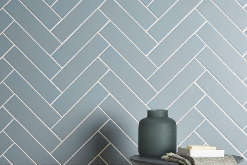 herringbone wall using mint coloured tiles