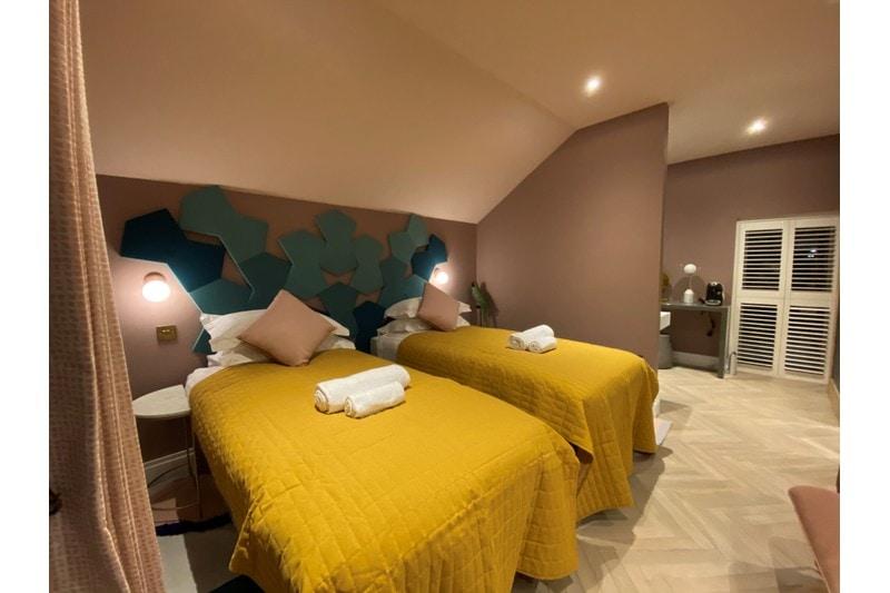 colourful bedroom with white oak herringbone