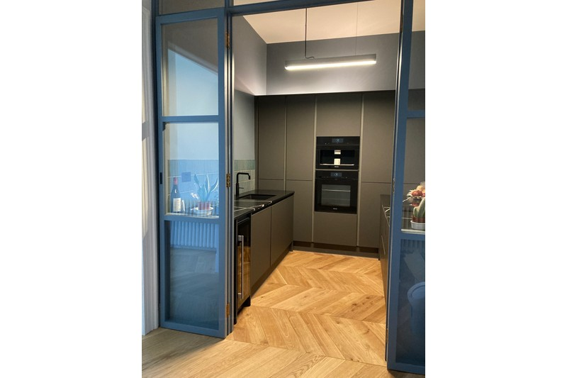 oak chevron flooring in kitchen