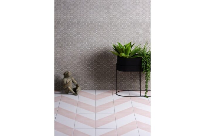 grey mosaic on wall with Demi PInk porcelain tile on the floor