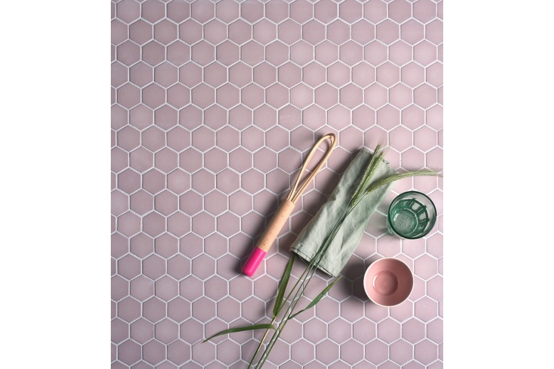 pink glass mosaic with kitchen utensil sitting on top