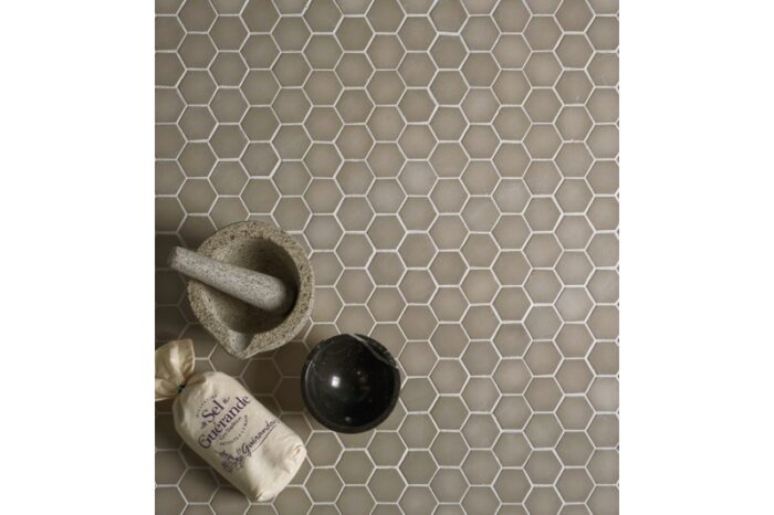 brown glass mosaic with kitchen utensil sitting on top