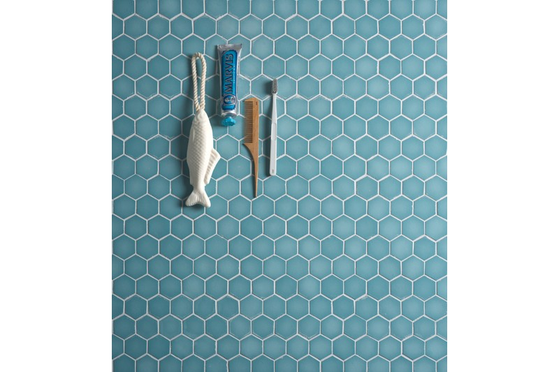 blue glass mosaic with kitchen utensil sitting on top