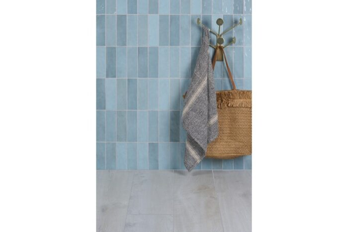 blue wall tile with coat hook